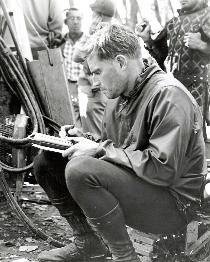 CHUCK WRITING IN HIS PERSONAL JOURNAL ON THE SET OF THE WAR LORD